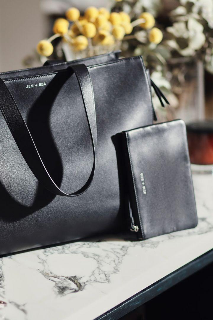 Satchel diaper bag made of black leather